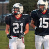 Tribune-Star/Joseph C. Garza<br /> RB and WR: Terre Haute North running back Daniel Gabbard and wide receiver Chad Holler take their positions as they prepare for the next play against Castle Friday, Aug. 21 at North.