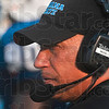 Tribune-Star/Joseph C. Garza<br /> Moving the Xs and Os: Indiana State head football coach Trent Miles watches his offense run the next play against Quincy Thursday at Memorial Stadium.