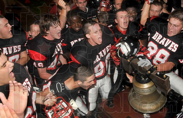 Tribune-Star file photo/Joseph C. Garza<br /> Staying on the southside: Members of the Terre Haute South football team celebrate the team's victory over Terre Haute North Friday, Aug. 29, 2008 at Memorial Stadium.