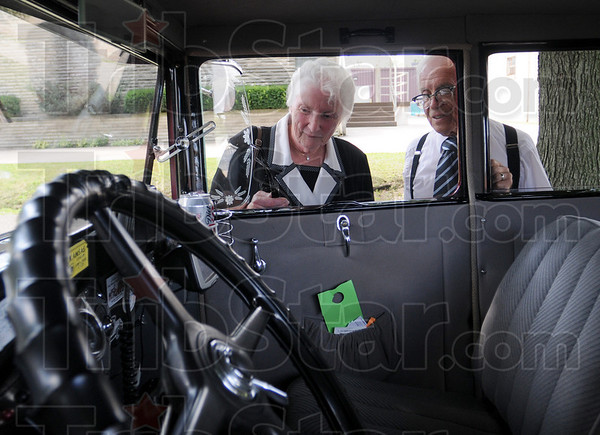 Remember when: Terre Haute residents Dick and Susan Cross look inside a 1930 Ford  during the Grand Indiana Auto Tour stop at the police and fire museum Thursday afternoon.