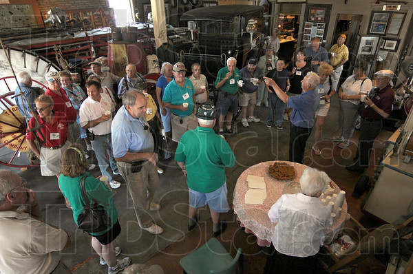 Museum visit: Participants in the Grand Indiana Auto Tour get information about the Terre Haute Police and Fire Museum from Tom Champion Thursday afternoon.