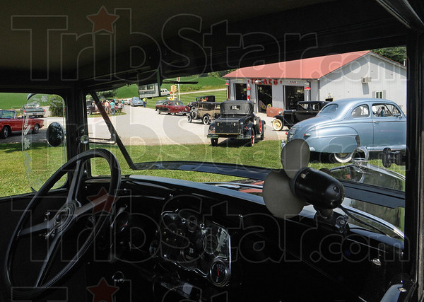 Garage: Participants in the Grand Indiana Auto Tour leave the Turner Garage on Greencastle Road Thursday afternoon, headed for their next stop at the police and fire museum.