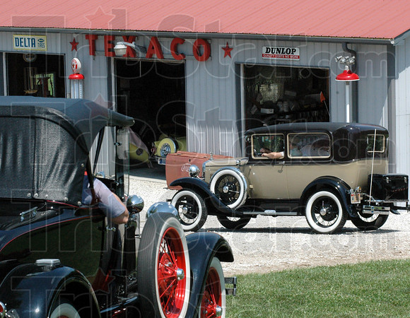 Grand tour: Participants in the Grand Indiana Auto Tour visited the Turner Garage on Greencastle road as part of their event Thursday afternoon.