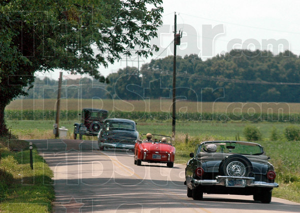 On tour: Participants in the Grand Indiana Auto Tour drive along a northern Vigo Co. road Thursday afternoon.