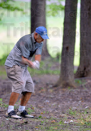 Tough lie: Larry Griffin hits through the trees on the back nine Sunday to place second in the Men's Senior championships.