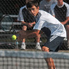 Tribune-Star/Joseph C. Garza<br /> No. 1 singles: Terre Haute North's Nick Roby finesses a backhand to his Greenwood opponent during their No. 1 singles match Saturday at North.
