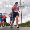 Tribune-Star/Joseph C. Garza<br /> In step: Forward Motion Athletics members Mike Morris, Dale Blunk, Butch Bosworth and Honnalora Hubbard run on a rural county road near Brazil Sunday as part of the triathlon team's workout.