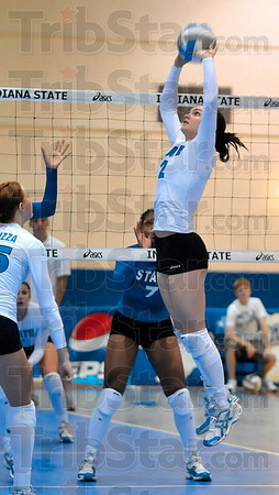 Tribune-Star/Joseph C. Garza<br /> The set up: Indiana State's Whitney Fromm sets the ball for a teammate during the Blue-White Scrimmage Sunday at Indiana State.