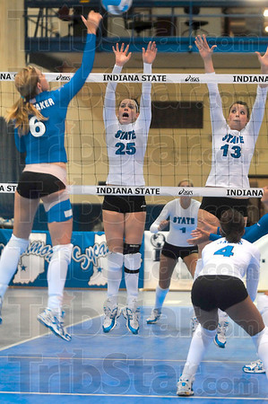 Tribune-Star/Joseph C. Garza<br /> Air defense: Indiana State's Kelli Whitaker spikes the ball against the defense of teammates Morgan Dall (25) and Shea Doran (13) during the Blue-White scrimmage Sunday at Indiana State.