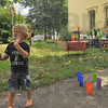 Pop: Ivan Hamilton tries his best to pop soap bubbles at the Farringtomn Grove Ice Cream Social Sunday afternoon.