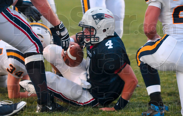 Tribune-Star/Joseph C. Garza<br /> He had to fight for that one: Terre Haute North quarterback Chris O'Leary is helped to his feet by a teammate after he scored against the Castle defense Friday at North. O'Leary was sandwiched by two defenders but still managed to score.