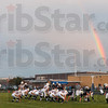 Tribune-Star/Joseph C. Garza<br /> Rainbow defense: Terre Haute North's defense stands ready for the next Castle play as a rainbow is seen in the background during the Patriots' game against the Knights Friday at North.