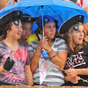 Rainy start: Terre Haute South students Jaqualynn Bogle, Mallory Metheny, Emma Bilyeu and Lexi Summers try to stay dry as rain showers rolled through about game time Friday evening.