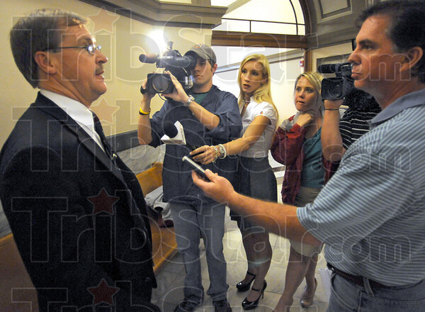 Media: Vigo Co. prosecutor Terry Modesitt speaks with Tribune-Star reporter Howard Greninger (R) after Katron Walker's sentencing Friday afternoon.