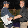 Mid field: Terre Haute North head football coach Chris Barrett receives congratulations from his opponent Mark Raetz after the Patriots 30-28 win Friday night.