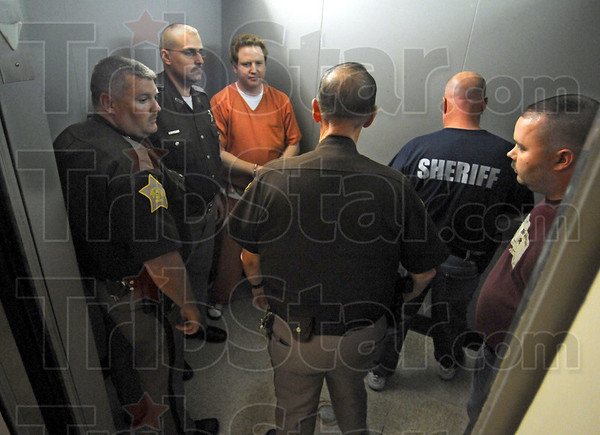 Going down: Katron Walker waits for the door to close on the elevator at the Vigo Co. Courthouse Friday afternoon after being sentenced to a total of 95 years in prison.