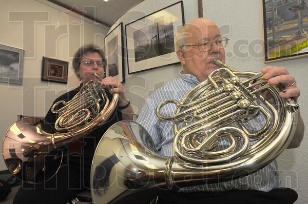 Duet: Nancy andDavid Watkins demonstrate their horns  last week at the Arts Illiana office in Downtown Terre Haute.
