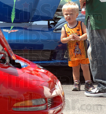 Corvette kid: Two-year-old Cody Lee Herman checks out the line of Corvettes during Saturday's ice cream social event in 12 Points.