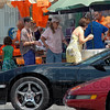 Cars, kids and cones: People attending the 12 Points ice cream social get in line for creamy treats Satuday afternoon near Lafayette and Maple Avenues.