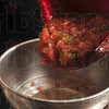 Tribune-Star/Joseph C. Garza<br /> Grab the chips and enjoy: Angela Cripe's chunky homemade salsa begs for a bag of tortilla chips as she pours it into a jar Tuesday at her Dennison, Ill., home.