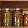 Tribune-Star/Joseph C. Garza<br /> Stored for later: Open a cabinet door in the Cripe household and you just might find jars of canned vegetables straight out of the family's garden.