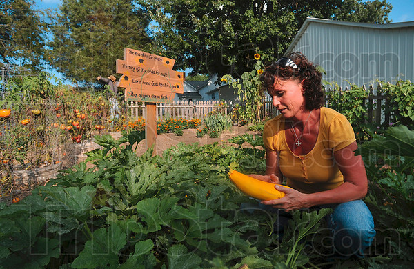 Tribune-Star/Joseph C. Garza<br /> Carefully planned and placed: Designed with tender care, Angela Cripe's garden at her home in Dennison, Ill., is the result of careful planning and placement.