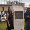 Tribune-Star/Joseph C. Garza<br /> In dad's honor: Kelli Ann Hall-Jones and Charles T. Hall, the daughter and son of Major Charles B. Hall, stand in front of the monument dedicated to their aviator father for a photo during the monument's dedication Saturday in front of Brazil City Hall.