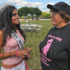 High profile help: Courtni Hall, Miss Indiana, chats with Judy Holmes at the Race for the Cure BBQ kickoff Saturday afternoon at the Meadows.
