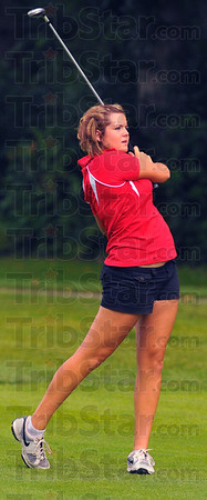 Brave golfer: Kelsey Fuqua hits on the front nine during the Patriot golf invitational Saturday.