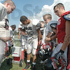 Water break: Members of the South football team take a water break during Wednesday's practice.