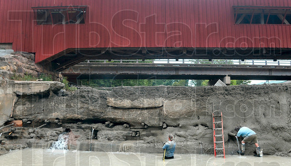 Tribune-Star/Joseph C. Garza<br /> Spray-on wall: Jimmy Nickles of AA Midwest Concrete sprays cement onto a dam wall at the Bridgeton Bridge Wednesday as Bridgeton Mill owner Mike Rowe does some detail work on the structure.