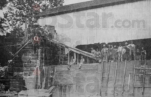 Tribune-Star/Joseph C. Garza<br /> First dam: A historic photo of the original dam built near the Bridgeton Bridge.