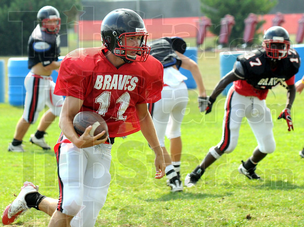 Carry: Bryn Schwartz carries the ball during Wednesday's practice as the team prepares for their season opener.