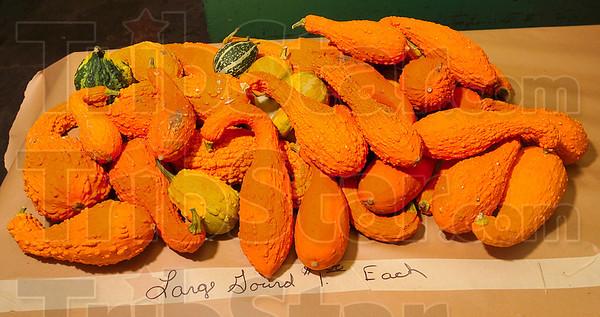 Tribune-Star/Joseph C. Garza<br /> Gourd variety: A pile of brightly hued gourds awaits customers at Poplar Street Farmers Market Wednesday.
