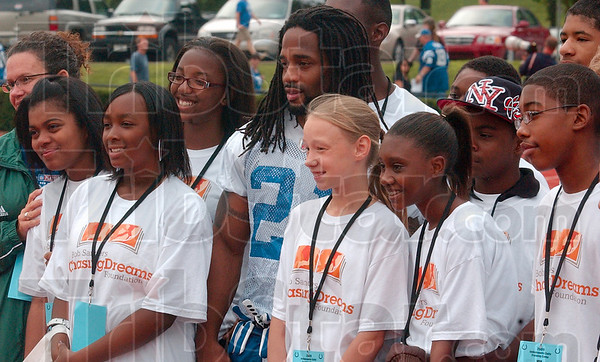 Tribune-Star/Joseph C. Garza<br /> Time for the kids: Indianapolis Colts defensive back Bob Sanders, center, poses for a photo with children participating in his Chasing Dreams Foundation Wednesday morning at Rose-Hulman.