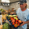 Tribune-Star/Joseph C. Garza<br /> Plentiful: With a walk-in refrigerator on site, Jamie Behem is able to offer fresh, crisp fruits and vegetables grown in his garden to customers at Poplar Street Farmers Market.