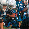Tribune-Star/Joseph C. Garza<br /> Jumping right in: Indianapolis Colts running back fakes the hand-off from quarterback Peyton Manning as he faces teammate, Keyunta Dawson, right, during team practice Monday at Rose-Hulman.