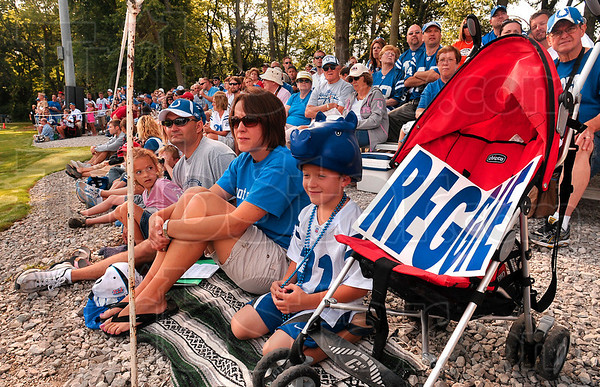 Tribune-Star/Joseph C. Garza<br /> Ready for Reggie: Indianapolis Colts fan, Landon Stoll, 7, of Haubstadt, watches practice Monday with his mom, dad and sister, Matt, Stephanie and Loren Stoll, at Rose-Hulman.