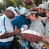 Tribune-Star/Joseph C. Garza<br /> A good day for the autograph seekers: If you hung around after the team's morning practice Monday at Rose-Hulman, you could have scored autographs from the Indianapolis Colts' head coach, Jim Caldwel along with Peyton Manning and Dallas Clark.