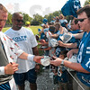 Tribune-Star/Joseph C. Garza<br /> Signed by an MVP: Nick Gillette, right, takes back a mini helmet from Indianapolis Colts quarterback, Peyton Manning, after Manning signed it after morning practice Monday at Rose-Hulman.