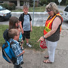 Tribune-Star/Joseph C. Garza<br /> No strangers at the crossing: Ouabache Elementary School students Brayden Renfro, Haley Renfro and Matthew Prohl introduce themselves before crossing the street with the help of crossing guard Barb Houston Tuesday at the intersection of Seventh Street and Maple Avenue. Houston estimated that she has been a crossing guard for at least 15 years and enjoys interacting with the children.
