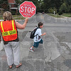 "Tribune-Star/Joseph C. Garza<br /> Crossing guard Barb Houston stops traffic for Ouabache Elementary School second-grader as he sprints across Seventh Street at Maple Avenue Tuesday. ""All of my children are respectful,"" said Houston of the youngsters that cross at the intersection. ""It's just a good corner,"" she later added."