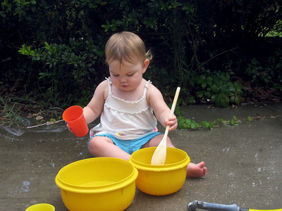 Anna got to play with water at Grandma's