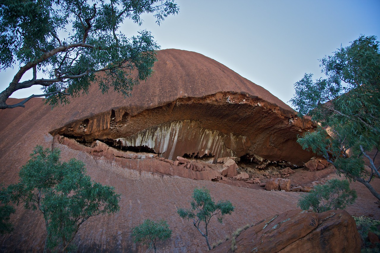 A toothy grin on one side of Ayers' Rock.