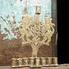 Menorah made by Birhanu Reta. He lacks any market opportunities for his product.  Further, Jewish buyers never see the Judaic pieces he makes.
