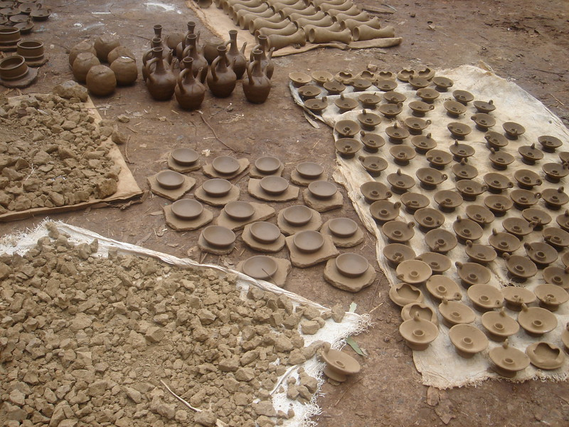 Pottery projects drying in the sun. The potters have no wheels to create their works or kilns to dry them.
