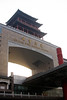 The massive entrance of Beijing West train station towers overhead.