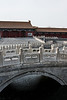 A gentle stream flows through a courtyard in the forbidden city.