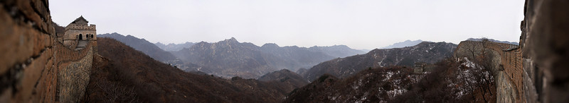 A 180 degree pano shows the view toward the former land of the Mongols from the impenetrable defense of the wall.  At full res, the wall can be seen descending the ridge on the right into this valley and ascending the opposite side to a saddle near the center of the photo.