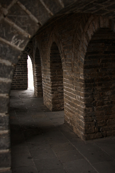 Light from the windows floods the interior of one of the many watch towers along the Great Wall.